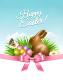 Spring Easter background. Easter eggs in grass with flowers. Stock Photos