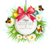 Spring Easter background. Easter eggs in grass with flowers. Royalty Free Stock Images