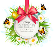 Spring Easter background. Easter eggs in grass with flowers. Royalty Free Stock Photo