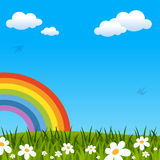 Spring or Easter Background with Rainbow. Easter or spring background with blue sky, green grass, flowers and a rainbow. Eps file available Stock Image