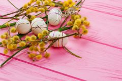 Spring Easter composition with decorative eggs. Modern Easter eggs, pussy willow twigs and grass with copy space. Spring season holiday. Best Easter egg design Royalty Free Stock Image