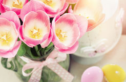 Spring easter composition of pink tulips and colorful eggs Royalty Free Stock Images