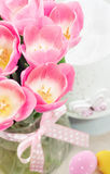 Spring easter composition of pink tulips and eggs Royalty Free Stock Image