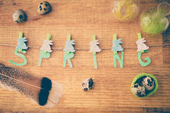 Spring and Easter composition with quail eggs  on wooden table Royalty Free Stock Photos