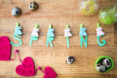 Spring and Easter composition with quail eggs  on wooden table Stock Photo