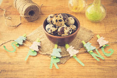 Spring and Easter composition with quail eggs  on wooden table Stock Images