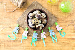 Spring and Easter composition with quail eggs  on wooden table Stock Photography