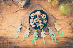 Spring and Easter composition with quail eggs  on wooden table Royalty Free Stock Image