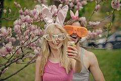 Spring. Easter. love. Spring. Easter. Happy couple in love making selfie on smartphone at blossoming magnolia trees stock photography