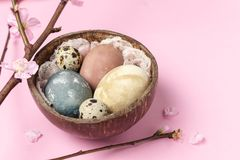 Spring easter minimal background rustic style composition - organic naturally dyed easter eggs stock photo