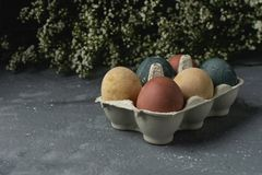 Spring easter minimal background rustic style composition - organic naturally dyed easter eggs. Spring easter minimal rustic style concept - organic naturally stock photo