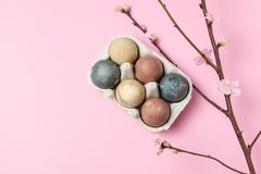 Spring easter minimal background rustic style composition - organic naturally dyed easter eggs. Spring easter minimal concept - organic naturally dyed easter stock photos