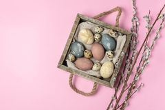 Spring easter minimal background rustic style composition - organic naturally dyed easter eggs. Spring easter minimal concept - organic naturally dyed easter royalty free stock images