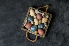 Spring easter minimal background rustic style composition - organic naturally dyed easter eggs royalty free stock photo