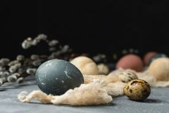 Spring easter minimal background rustic style composition - organic naturally dyed easter eggs, willow banch royalty free stock photos