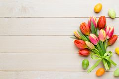 Spring easter tulips in bucket on white vintage background. Spring easter tulips in bucket on white vintage background Royalty Free Stock Photos