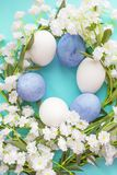 Spring eggs texture background. Spring blue eggs on a textured background Royalty Free Stock Photo