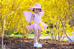 Spring fairy. Two year old girl dressed as fairy enjoying spring flowers Royalty Free Stock Photography