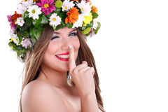 Spring fairy with finger on lips Stock Images