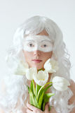 Spring fairy. Young woman in white wig with Stock Photos