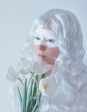 Spring fairy. Young woman in white wig with Stock Photo