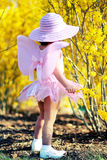 Spring fairy4. Two year old girl dressed as fairy enjoying spring flowers Stock Photography