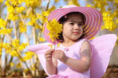 Spring fairy5. Two year old girl dressed as fairy enjoying spring flowers Stock Photo