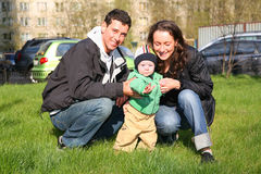 Spring family with baby. In yard stock images