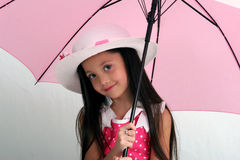 Spring fashion. Young girl in white summer hat holding pink umbrella Stock Images