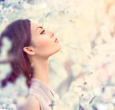 Spring fashion girl outdoor portrait. In blooming trees stock photo