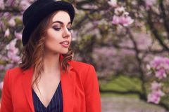 Spring fashion girl outdoors portrait in blooming trees. Beauty Romantic woman in flowers. Sensual Lady enjoying Nature. royalty free stock image