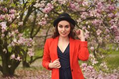 Spring fashion girl outdoors portrait in blooming trees. Beauty Romantic woman in flowers. Sensual Lady enjoying Nature. royalty free stock images