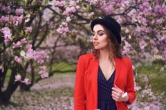 Spring fashion girl outdoors portrait in blooming trees. Beauty Romantic woman in flowers. Sensual Lady enjoying Nature. stock image