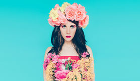 Spring fashion lady with bouquet of beautiful flowers Stock Photos