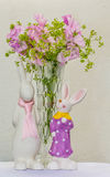 Spring feeling. A vase of flowers and two charming easter bunny Stock Images