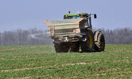 Spring fertilizing fertilizers_11. Chortkiv - Ternopil - Ukraine - April 1, 2017. Spring fertilizing fertilizers sowing winter rape in the private agribusiness Stock Images