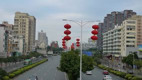 The Spring Festival is coming, the red lanterns hanging on the city roads stock footage