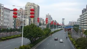 The Spring Festival is coming, the red lanterns hanging on the city roads stock video