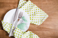 Spring Festive Table Setting for Easter Dinner. Spring Festive Table Setting for Easter Dinner with Cutlery and Napkin on Wooden Rustic Table. Selective Focus Royalty Free Stock Images