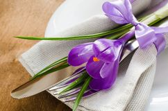 Spring Festive Table Setting With Fresh Flower. Napkin, plate and cutlery on wooden table. Holidays background. Selective Focus Royalty Free Stock Photography