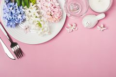 Spring festive Table setting with hyacinth flowers on a pink background.  Royalty Free Stock Photography