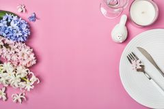 Spring festive Table setting with hyacinth flowers on a pink background.  Stock Image