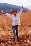 Spring fever. Middle-aged in a Reed field when the sun shines in the spring Stock Photo