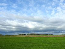 Spring field and beautiful cloudy sky, Lithuania Stock Image