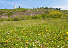 Spring field and fortress and church behind Stock Images