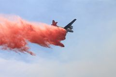 Spring Fire ~ 2013 ~ Fire Retardant Drop #1. Photo of plane dropping fire retardant during the Spring Fire of 2013 in Camarillo California. Please check out my stock photography