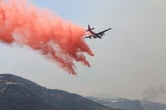 Spring Fire ~ 2013 ~ Fire Retardant Drop #5. Photo of plane dropping fire retardant during the Spring Fire of 2013 in Camarillo California. Please check out my royalty free stock photos