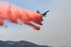 Spring Fire ~ 2013 ~ Plane Dropping Fire Retardant Stock Photo
