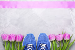 Spring flatlay composition with sneakers and tulips. Royalty Free Stock Photography