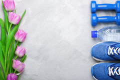Spring flatlay composition with sport equipment and tulips. Royalty Free Stock Photos